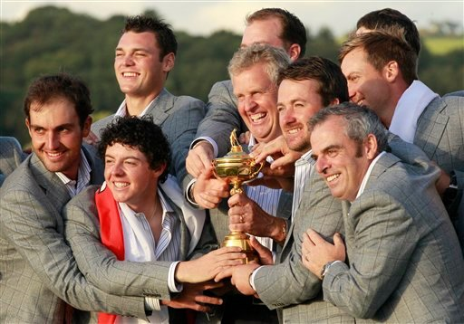 Europe team members hold the trophy after winning the 2010 Ryder Cup golf tournament at the Celtic Manor Resort in Newport, Wales, Monday, Oct. 4, 2010.