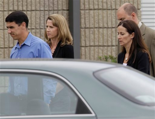 From left, Grant Mills, Kathleen Mills, Jason Stannard, upper right, and Caroline DeWeese, mother of Anthony DeWeese, arrive at a Coast Guard court hearing in Alameda, Calif. They were aboard the boat that was struck by the Coast Guard vessel.