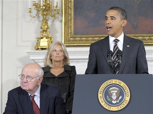 President Barack Obama, accompanied by President's Economic Recovery Advisory Board (PERAB) Chairman Paul Volcker, left, and Dr. Jill Biden, wife of Vice President Joe Biden, addresses the PERAB, Monday, Oct. 4, 2010
