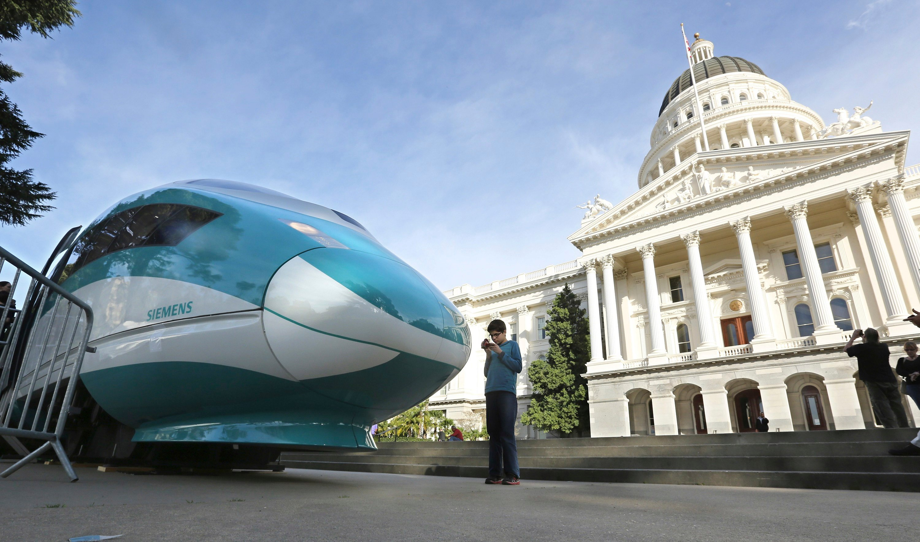 FILE - In this Feb. 26, 2015 file photo, a full-scale mock-up of a high-speed train is displayed at the Capitol in Sacramento, Calif. (AP Photo/Rich Pedroncelli, File)