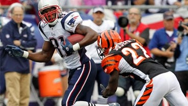 Sept. 12, 2010 file photo: New England Patriots wide receiver Randy Moss (81) pulls away from Cincinnati Bengals cornerback Johnathan Joseph (22) en route to a first down during the second quarter of a game in Foxborough, Mass. (AP Photo/Stephan Savoia)
