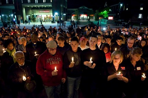 In this Oct. 3, 2010 file photo, people participate in a candlelight vigil for Rutgers University freshman Tyler Clementi at Brower Commons on the Rutgers campus in New Brunswick, N.J.