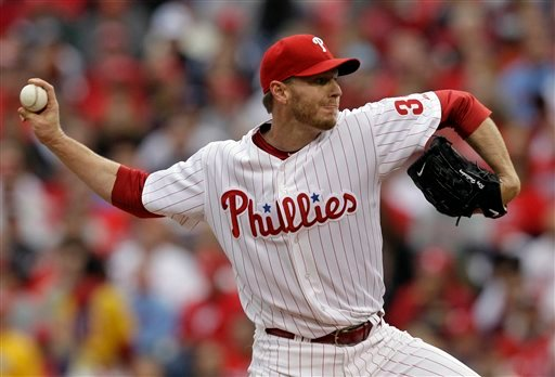 Philadelphia Phillies starting pitcher Roy Halladay delivers to a Cincinnati Reds batter during the first inning of Game 1 of the National League Division baseball series Wednesday, Oct. 6, 2010, in Philadelphia. (AP Photo/Rob Carr)