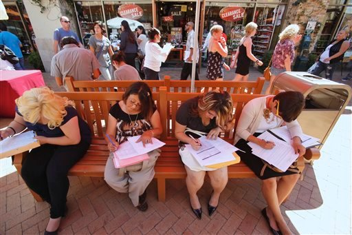 "Job seekers fill out job applications for retail positions at the ""End of Summer Job Fair,"" a one day event co-hosted at Citadel Outlets in partnership with the City of Commerce on Sept. 16, 2010, in Commerce, Calif. (AP Photo/Damian Dovarganes)"