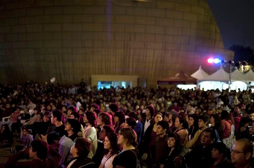 In this Oct. 3, 2010 photo, people attend a concert at Tijuanarte Art Festival in Tijuana, Mexico.