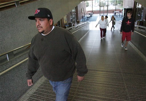 Victor Perez, left, walks to a news conference with his family on Tuesday, Oct 5, 2010 in Fresno, Calif.