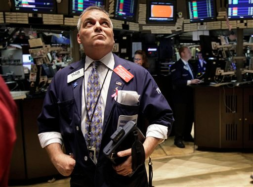 Trader Albert Young watches the board as he works on the floor of the New York Stock Exchange Friday, Oct. 8, 2010. (AP Photo/Richard Drew)