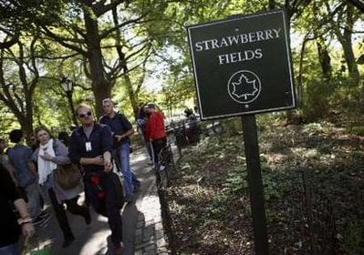 Tourists walk through the Strawberry Fields section of New York's Central Park October 6, 2010, which is dedicated to the memory of John Lennon.