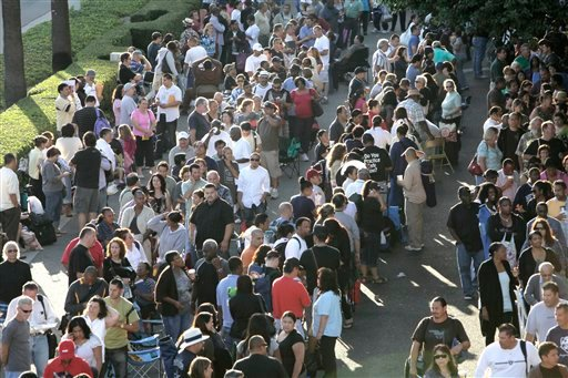 In this Sept. 30, 2010 photo, thousands of people wait in line at the Los Angeles Convention Center for free mortgage help in downtown Los Angeles. (AP Photo/Nick Ut)