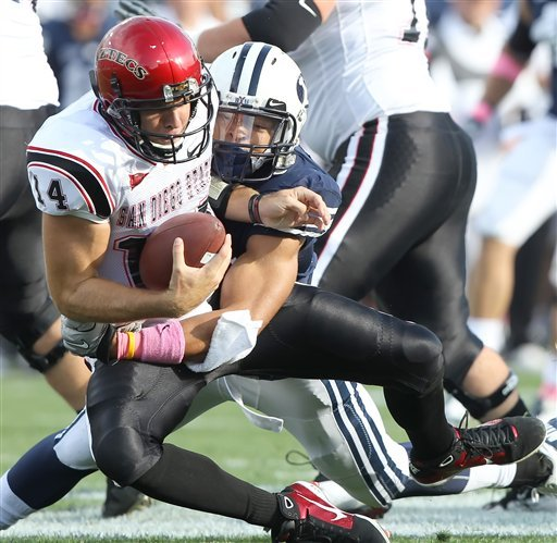 San Diego State's quarterback Ryan Lindley, left, is sacked by BYU's Kyle Van Nay during the first half of an NCAA college football game at LaVell Edwards Stadium in Provo, Utah, Saturday, Oct. 9, 2010. (AP Photo/George Frey)
