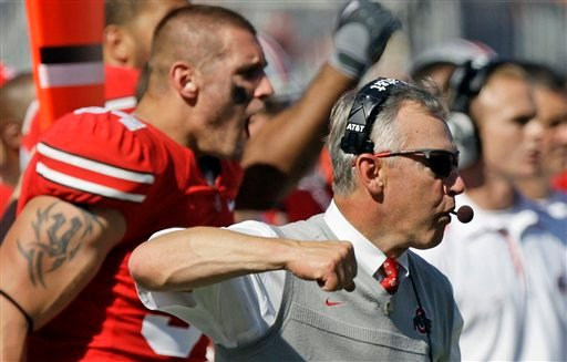 Ohio State's coach Jim Tressel celebrates a defensive play against Indiana during the fourth quarter of an NCAA college football game Saturday, Oct. 9, 2010.  (AP Photo/Jay LaPrete)