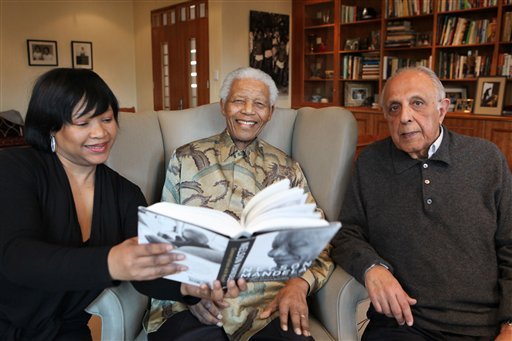 In this undated image released Monday, Oct. 11, 2010, by the Nelson Mandela Foundation, showing elder statesman Nelson Mandela , center, with his daughter Zindzi, and Ahmed Kathrada. (AP Photo/Debbie Yazbek, Nelson Mandela Foundation)