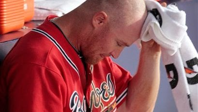 Atlanta Braves second baseman Conrad Brooks sits in the dugout after the Braves lost 3-2 to the San Francisco Giants in Game 3 of baseball's National League Division Series on Sunday, Oct. 10, 2010. (AP Photo/Dave Martin)