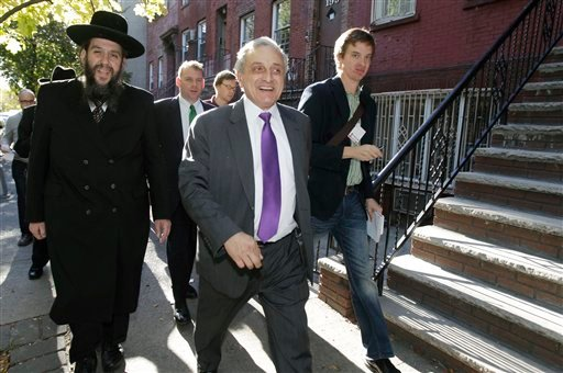 Rabbi Yehuda Levin, left, walks with New York Republican gubernatorial candidate Carl Paladino, center. (AP Photo/Kathy Willens)