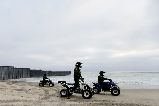 In this June 22, 2016, file photo, Border Patrol agents ride vehicles along where the border meets the Pacific Ocean in San Diego.