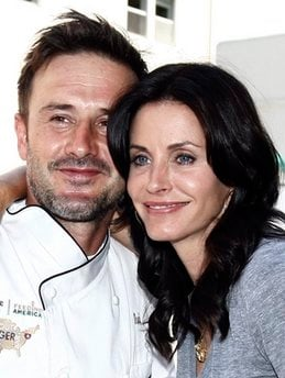 FILE - In this Aug. 31, 2009 file photo, David Arquette, left, and Courteney Cox Arquette pose together at the launch of The Cheesecake Factory's Drive Out Hunger Tour benefiting Feeding America in Culver City, Calif.