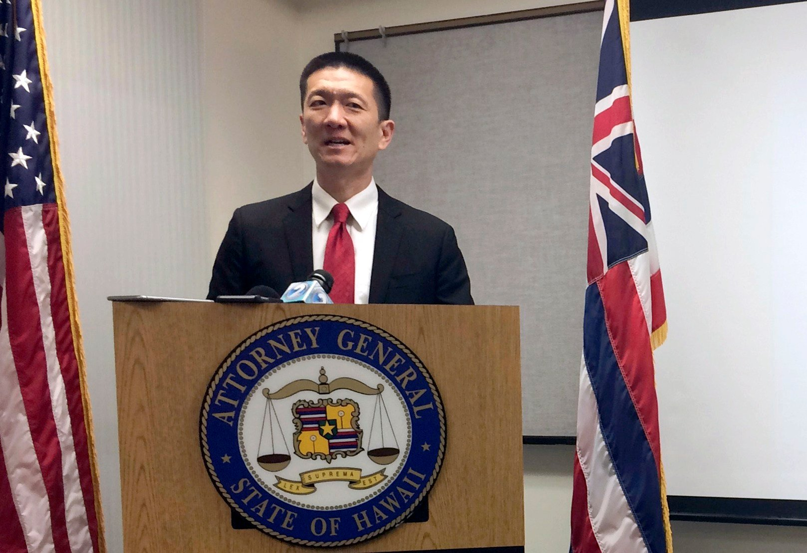 FILE - In this Feb. 3, 2017, file photo, Hawaii Attorney General Doug Chin speaks at a news conference in Honolulu announcing the state of Hawaii has filed a lawsuit challenging President Donald Trump's travel ban. (AP Photo/Audrey McAvoy, File)