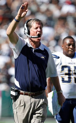 San Diego Chargers head coach Norv Turner signals during the first half of an NFL football game against the Oakland Raiders in Oakland, Calif., Sunday, Oct. 10, 2010. (AP Photo/Tony Avelar)