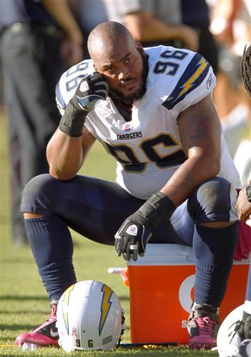 San Diego Chargers defensive end Travis Johnson (96) sits on the sidelines against the Oakland Raiders in the fourth quarter. (AP Photo/Tony Avelar)