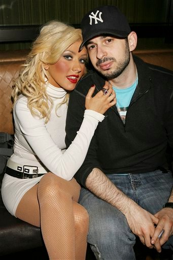 FILE - In this March 23, 2007 file photo originally provided by Starpix, singer Christina Aguilera and her husband Jordan Bratman attend a party at the Marquee club in New York. (AP Photo/Dave Allocca, Starpix, file)