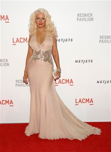 Singer Christina Aguilera arrives at the LACMA Resnick Exhibition Pavilion grand opening gala in Los Angeles on Saturday, Sept. 25, 2010. (AP Photo/Dan Steinberg)