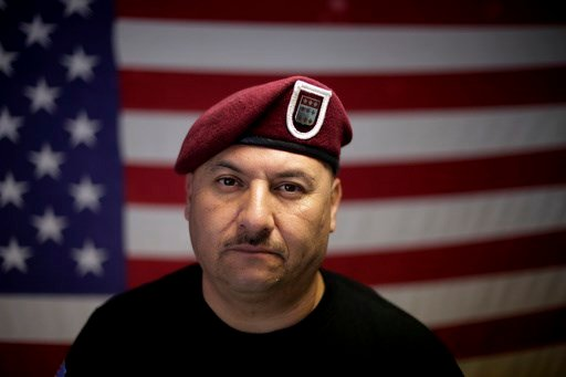 """In this Feb. 13, 2017 photo, U.S. Army veteran Hector Barajas, who was deported, poses for a portrait in his office at the Deported Veterans Support House, nicknamed """"the bunker"""" in Tijuana, Mexico."""