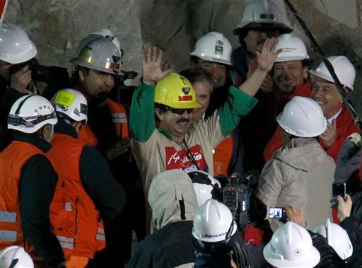 Rescued miner Juan Andres Illanes Palma, third miner to be rescued, salutes at his arrival to the surface.