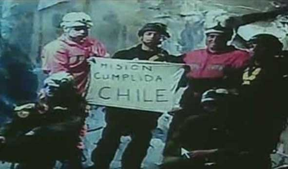 Rescue workers who helped the 33 trapped Chilean miners hold up a sign 2,000 feet below the earth.