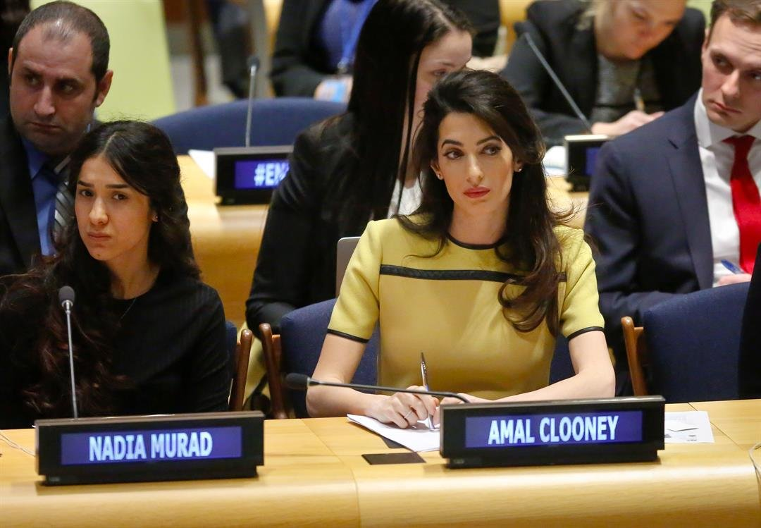 "Human rights lawyer Amal Clooney, right, and her client Nadia Murad, left, a human rights activist and Yazidi genocide survivor, listen during a United Nations human rights meeting called ""The Fight against Impunity for Atrocities: Bringing Da'esh [ISIS]"