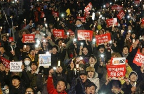 Protesters shout slogans during a rally calling for impeached President Park Geun-hye's arrest in Seoul, South Korea.