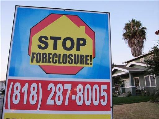 In this file photo taken Aug. 8, 2010, a foreclosure sign is posted outside a home in Los Angeles. U.S. home repossessions spiked in August to highest level since start of U.S. mortgage crisis. (AP Photo/Paul Sakuma, File)