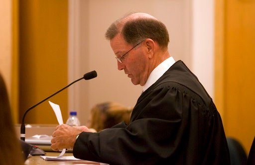 In this June 2, 2009 file photo, Judge Ben Burgess presides over a hearing in Wichita, Kan.