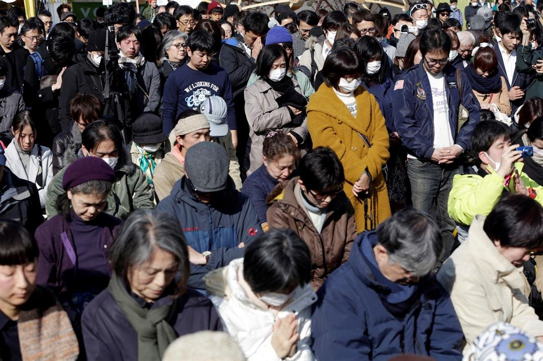 People mourn the victims of the March 11, 2011 earthquake and tsunami during a special memorial event in Tokyo, Saturday, March 11, 2017. (AP Photo/Eugene Hoshiko)