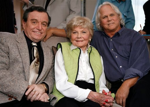 "In this Sept. 27, 2007 file photo, Jerry Mathers, Barbara Billingsley, and Tony Dow, cast of ""Leave It To Beaver"", pose for a photo as they are reunited in Santa Monica, Calif., to celebrate the 50th anniversary of the show.  (AP Photo/Damian Dovarganes)"