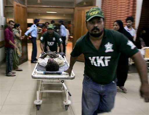 In this Saturday, Oct. 16, 2010 photo, an injured victim of shooting incident is brought to a local hospital in Karachi, Pakistan. (AP Photo/Fareed Khan)