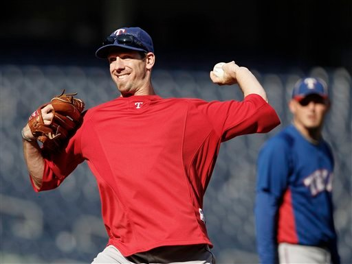 Texas Rangers' Cliff Lee winds up during a pitching drill on the mound during a baseball workout at Yankee Stadium in New York, Sunday, Oct. 17, 2010. (AP Photo/Kathy Willens)