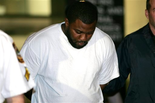 In this May 21, 2009 file photo, Onta Williams is led by police officers from a federal building in New York after being arrested by the FBI on charges for plotting to bomb New York synagogues and shoot down military aircraft.