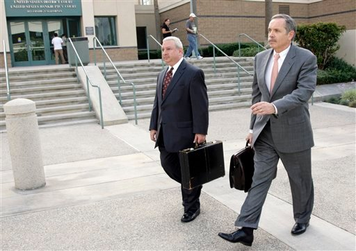 Attorney Dan Woods, right, leaves the United States District Court in Riverside, Calif. (AP Photo/Francis Specker)