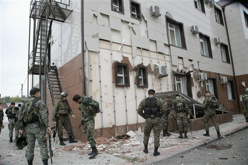 Special Force (OMON) officers are seen in front of Chechen parliament complex after a bomb blast in Grozny, Chechnya, southern Russia, Tuesday, Oct. 19, 2010. (AP Photo/Musa Sadulayev)