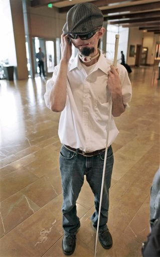 Dallas Wiens, 25, speaks on a cell phone in Fort Worth, Texas, Wednesday, Oct. 13, 2010. Weins was critically burned in a 2008 high-voltage power line accident and is waiting for a face transplant. (AP Photo/LM Otero)