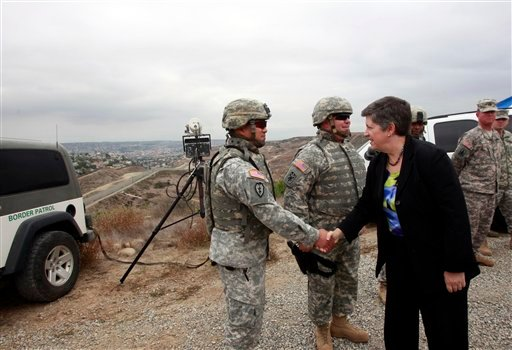 Secretary of Homeland Security Janet Napolitano visits with California National Guard troops on a hill overlooking the border during a brief tour Monday, Oct. 18, 2010, in San Diego. (AP Photo/Lenny Ignelzi, Pool)