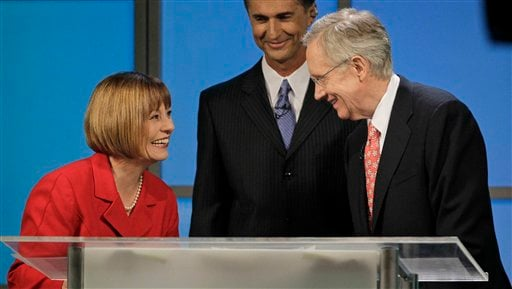 In this Oct. 14, 2010, file photo Republican Senate candidate Sharron Angle, left, and Democrat Senate Majority Leader Harry Reid talk after their televised Nevada Senate debate in Las Vegas. (AP Photo/Julie Jacobson, File)
