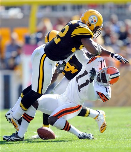 In this Oct. 17, 2010, file photo, Pittsburgh Steelers linebacker James Harrison (92) hits Cleveland Browns wide receiver Mohamed Massaquoi (11) during the second quarter of a an NFL football game in Pittsburgh.