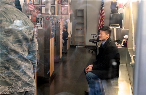 Dan Choi, right, an Iraq War veteran and a West Point graduate who was discharged from the military in July because he announced publicly that he is gay, sits waiting inside the U.S. Armed Forces Recruiting Center in Times Square(AP Photo/Bebeto Matthews)