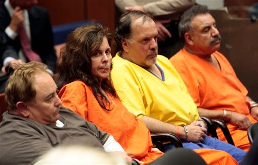 From left, Robert Rizzo, former Bell, Calif., city manager, Angela Spaccia, former assistant city manager, Victor Bello, former council member and Oscar Hernandez, mayor, appear in Los Angeles County Superior Court for a bail reduction hearing Wednesday.