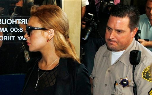 Lindsay Lohan arrives for a hearing at the Beverly Hills Courthouse in Beverly Hills, Calif., Friday, Sept. 24, 2010. (AP Photo/Nick Ut)
