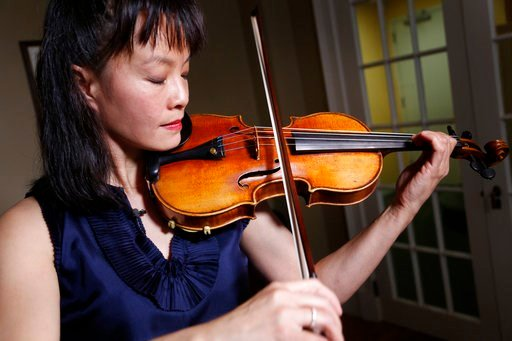 Mira Wang plays the Ames Stradivarius violin in New York, Wednesday, March 8, 2017.