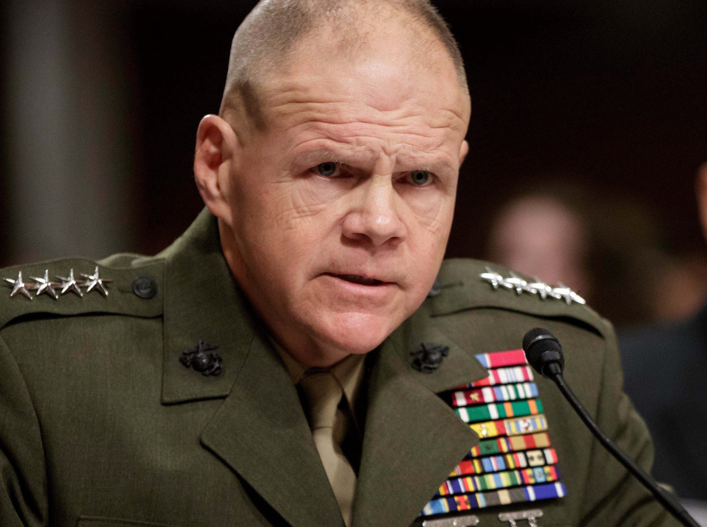 Marine Corps Commandant Gen. Robert B. Neller responds to an angry and skeptical Senate Armed Services Committee member Sen. Kirsten Gillibrand, D-N.Y. while testifying on Capitol Hill. (AP Photo/J. Scott Applewhite)