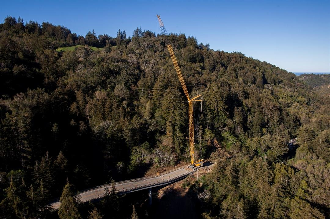 A crane sits on Highway 1 south of the Pfeiffer Canyon Bridge in Big Sur, Calif. (AP Photo/Nic Coury)