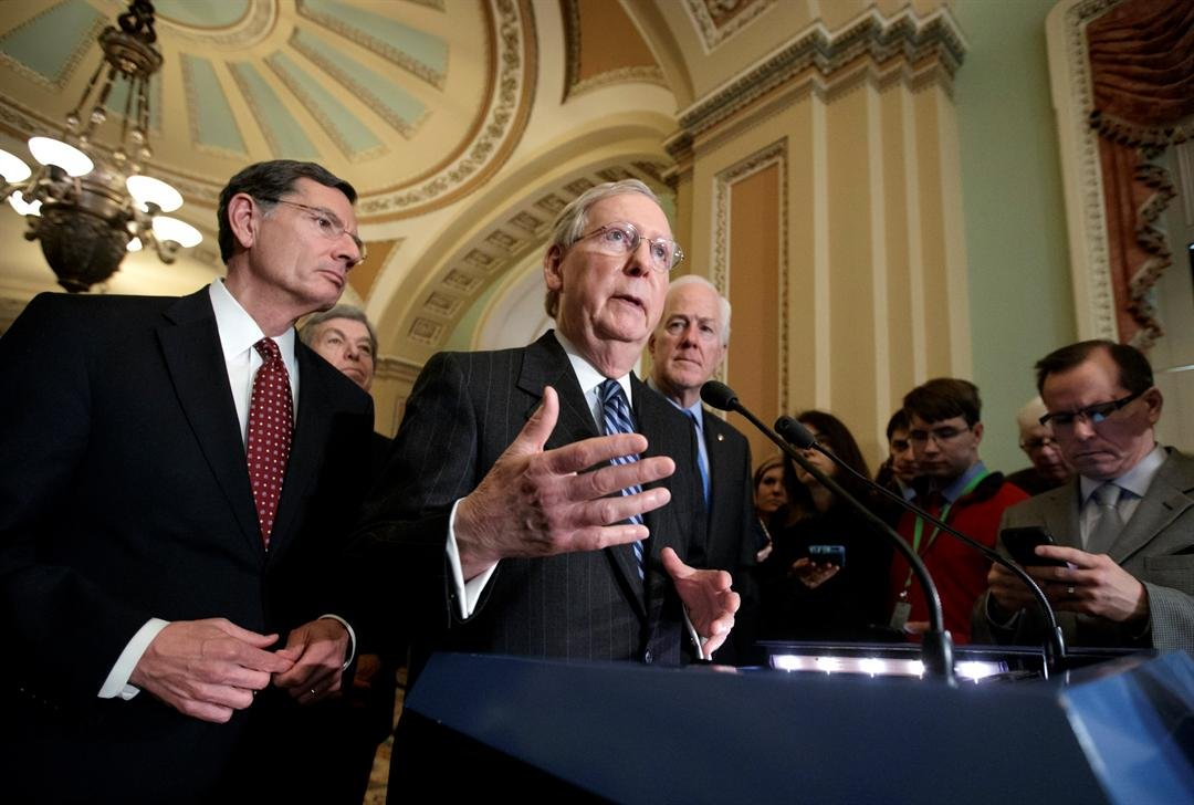 Senate Majority Leader Mitch McConnell, R-Ky., joined by, from left, Sen. John Barrasso, R-Wyo., Sen. Roy Blunt, R-Mo., and Majority Whip John Cornyn, R-Texas, speaks with reporters at the Capitol in Washington, Tuesday, March, 14, 2017.